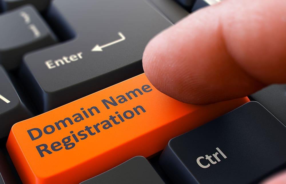 Finger Presses Orange Keyboard Button Domain Name Registration