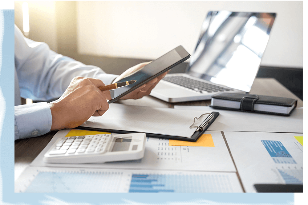 Businessman using tablet and doing finances